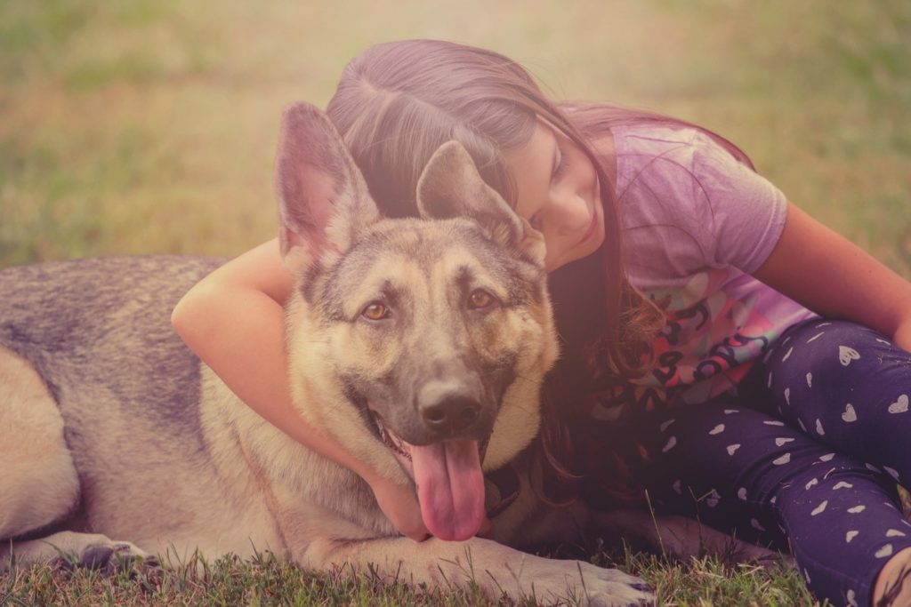 Girl cuddling her dog