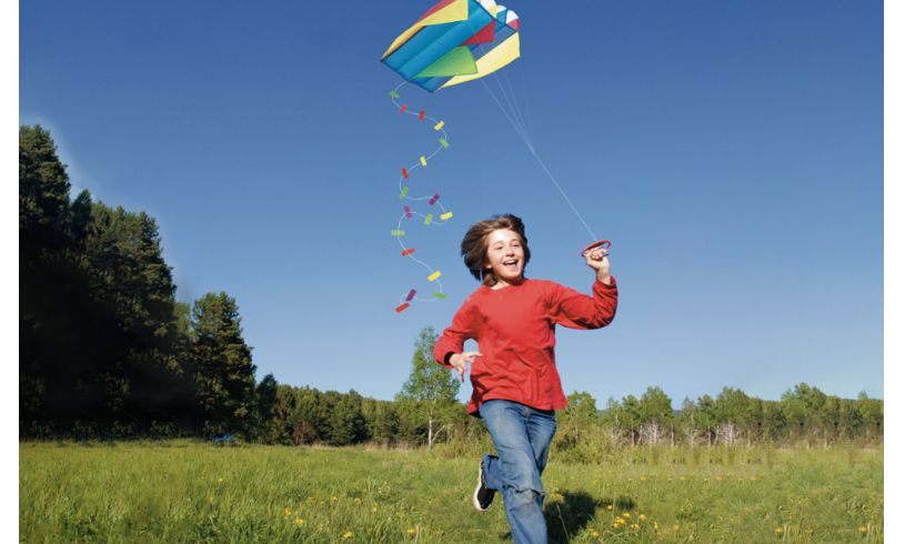A kid flying a pocket kite