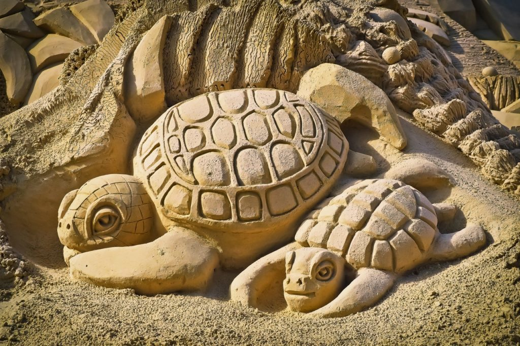 Sand art of mommy and baby turtles